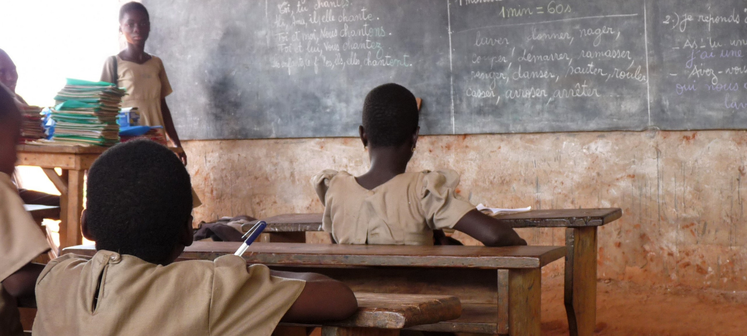 IIEP researchers visit a school in Togo while researching school grants.