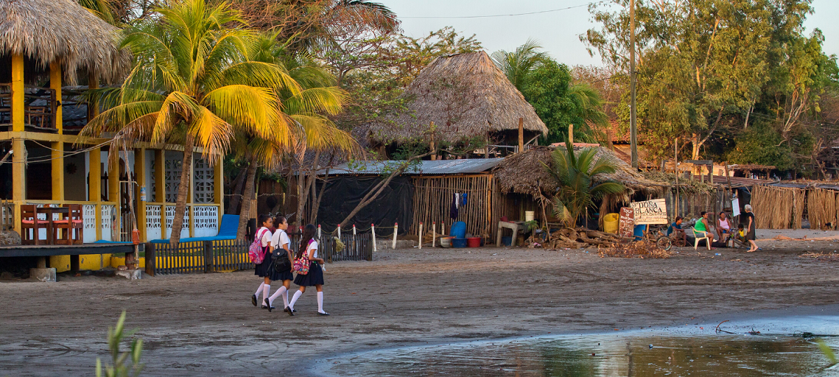 Girls coming back from school at sunset in a small village Nicaragua