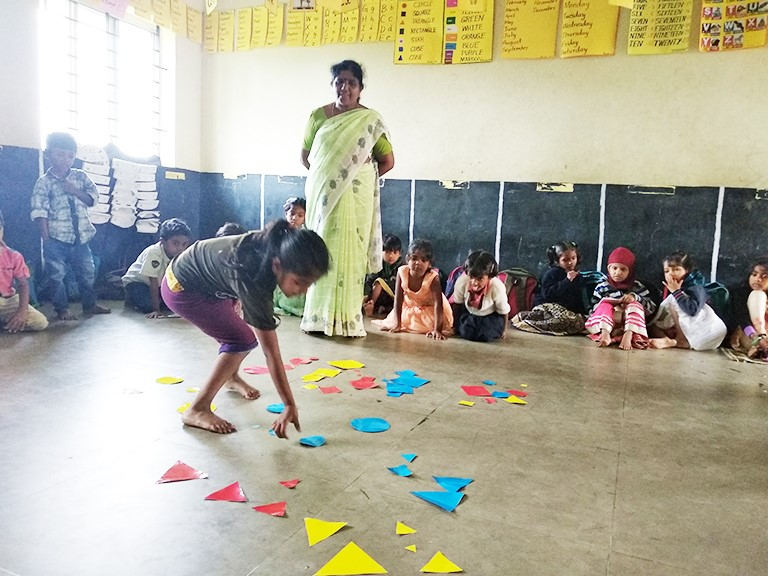 Students participating in activities as part of the SRP program in a classroom in Hassan, Karnataka